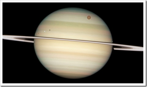 Enceladus, Dione, Titan and Mimas orbiting Saturn
